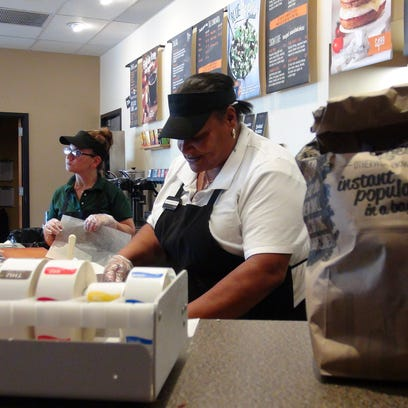 Jackie King, right, prepares breakfast orders at the