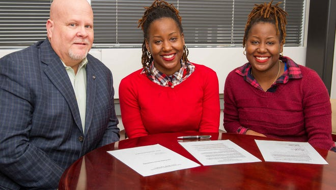 Phillip T. Ellmore (left), chief development officer and executive director of the Stockton University Foundation, Tracey Smith 'and Stacey Smith are shown at a gift signing on Stockton's campus. The twins pledged a gift of $1,000 annually for at least the next five years for a scholarship in memory of their late grandmother.
