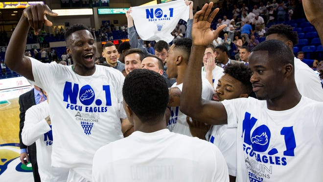Florida Gulf Coast University senior, Demetris Morant, #21, left, celebrates with his teammates after clinching the Atlantic Sun regular-season title and the No. 1 seed in the conference tournament against Stetson University on Thursday, February 23, 2017 at Alico Arena in Estero.
