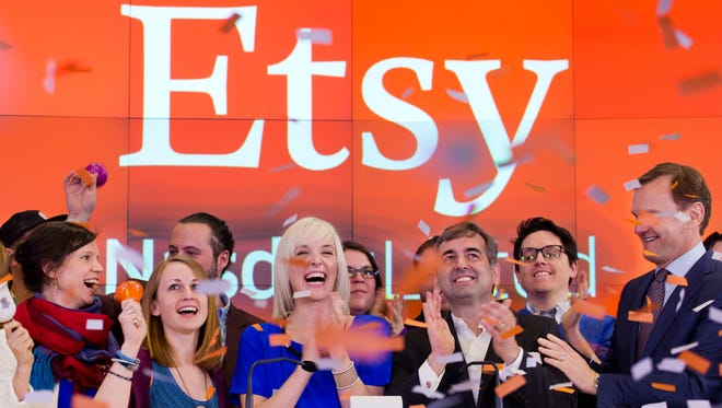 This April 16, 2015 file photo shows executives and guests of online crafts seller Etsy celebrating the company's Initial public offering.