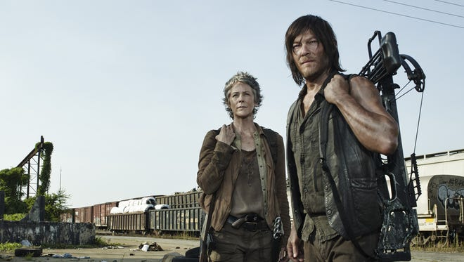 Melissa McBride as Carol Peletier and Norman Reedus as Daryl Dixon - The Walking Dead.