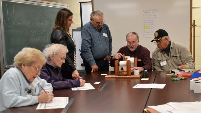 Candidates Dave Behrend, right, and Fran Wranowsky, second from right, watch Oconto County Board of Canvass member Ron Leja recount votes for the District 7 of the Oconto County Board on April 11 in a meeting room at the courthouse. From left a Board of Canvass members Delores Saucier and Leona Leja, who tally the votes separate sheets, and Oconto County Clerk Kim Pytleski.
