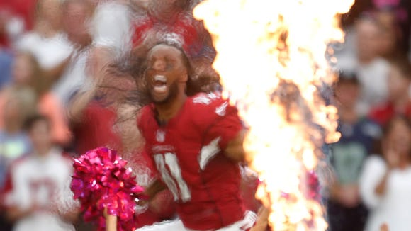 Larry Fitzgerald is fired up during pre-game introductions before playing the Washington Redskins.