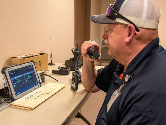 SAFD's Lt. Mike Young acts as incident commander, watching the real-time telemetry from the firefighter's equipment and instructing the Rapid Intervention Team (RIT) during a drill July 26, 2017.