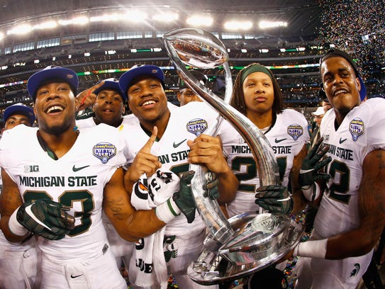 Michigan State's players celebrate their Cotton Bowl