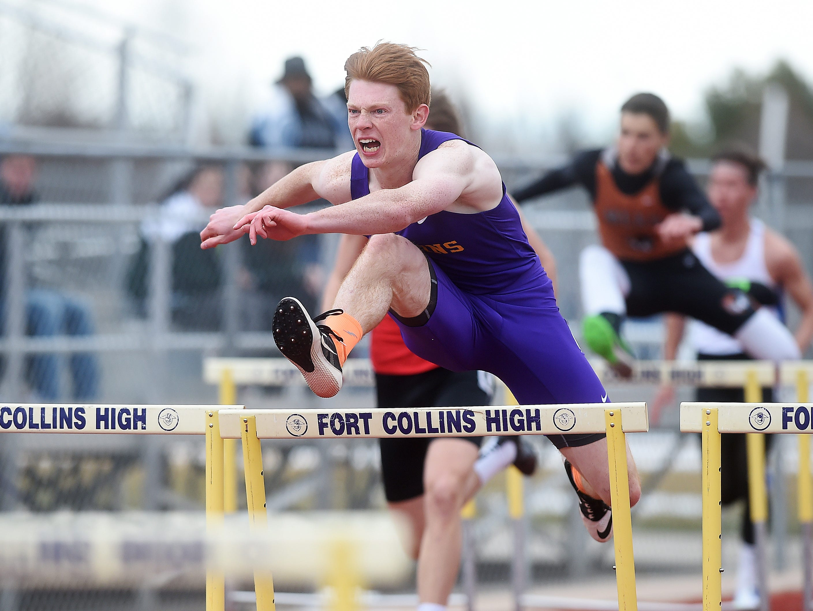 Fort Collins High School's Thomas Robillard competes in the 110-meter hurdle event during the Runners Roost Invite at Fort Collins High School on Friday, March 25, 2015. Robillard won the event in a personal-best time.