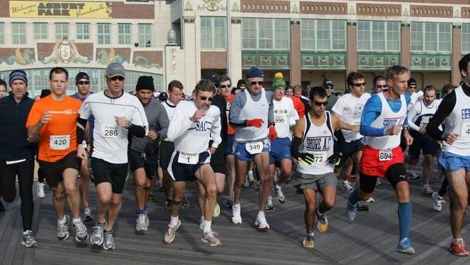 Runners take off at the start of the 46th annual Polar Bear Races, on the boardwalk in Asbury Park, on Dec. 27, 2009.