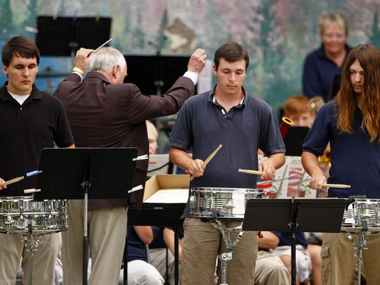 In this 2012 file photo, three percussionists, Brian Tremper, Jake Henneford and Tom Schaefer, play with the Municipal Band as Bud Nicholls directs.