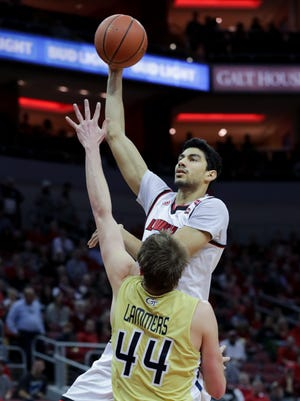 Louisville's Anas Mahmoud hooks a shot over Georgia Tech's Ben Lammers for two.