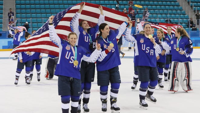 United States players celebrate after defeating Canada in the women's ice hockey gold medal match during the Pyeongchang 2018 Olympic Winter Games at Gangneung Hockey Centre.