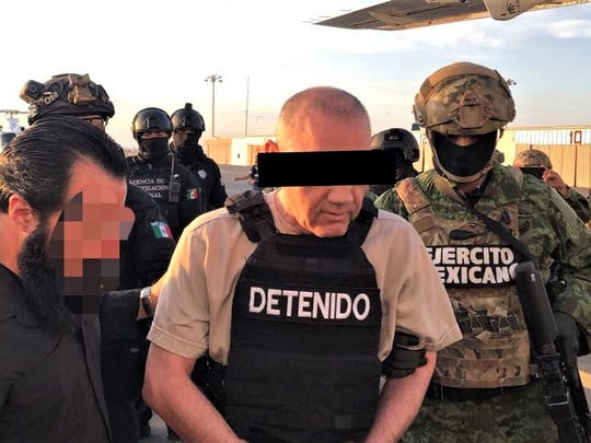 Mexican forces guard reputed Sinaloa cartel leader Damaso Lopez as he is handed to U.S. agents in Juárez, Mexico.
