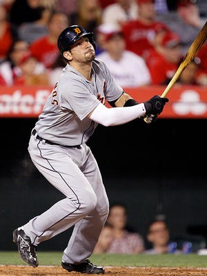 Nick Castellanos hits a sacrifice fly during Saturday night's loss to the Angels.