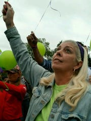 Michelle Gilmore releases a balloon at Thursday's recovery