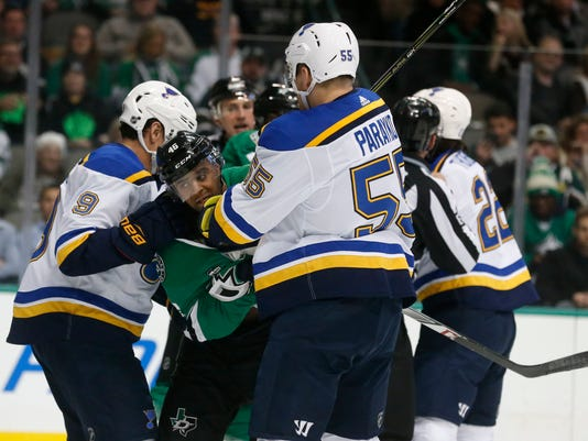 Dallas Stars center Gemel Smith (46) fights with St. Louis Blues right wing Scottie Upshall (9) and defenseman Colton Parayko (55) during the first period of an NHL hockey game in Dallas, Friday, Dec. 29, 2017. (AP Photo/Michael Ainsworth)