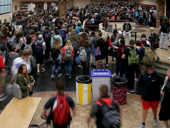 Freshmen and sophomores stream through the commons