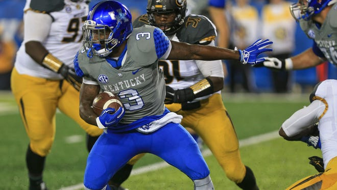 Kentucky running back JoJo Kemp runs for yardage in the second half. The Wildcats snapped an 18-game losing streak to ranked teams with the win over Missouri. Sept. 26, 2015