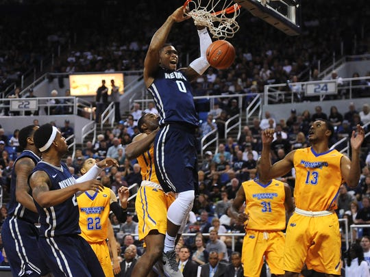 Nevada's Cameron Oliver dunks during the Wolf Pack's win over Morehead State on Friday night at Lawlor Events Center.