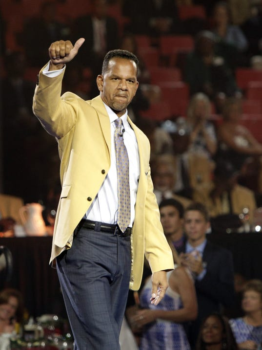 Andre Reed gestures to the audience Friday, Aug. 1, 2014 after receiving his gold jacket during the Pro Football Hall of Fame Enshrinees' Dinner in Canton, Ohio. The induction ceremony will take place Saturday in Canton's Fawcett Stadium (AP Photo / The Repository, Bob Rossiter)