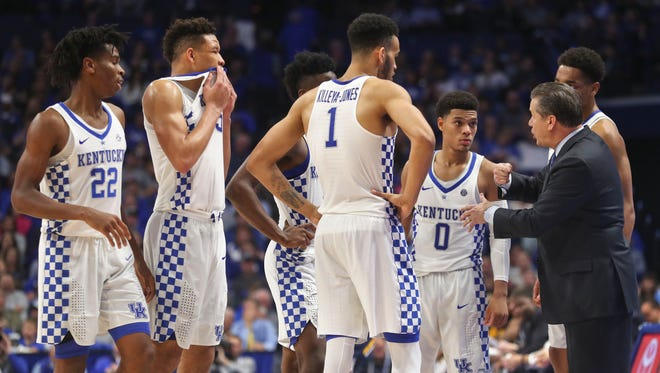 """Kentucky head coach John Calipari talks with his team in the second half Friday night at Rupp Arena. The Wildcats won 78-61 after a sluggish start early in the first half. """"I would tell our fans, just enjoy this, because I'm the one dying,"""" said Calipari afterwards."""