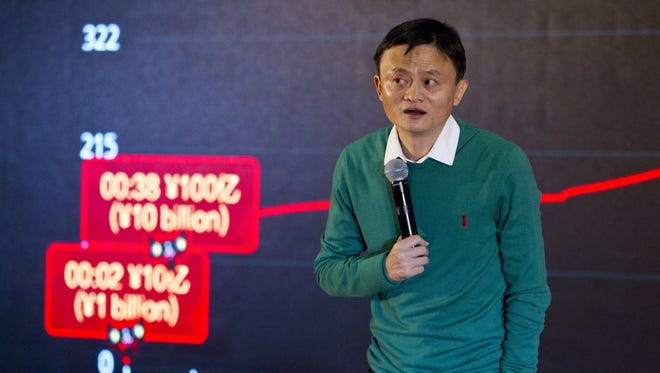 Jack Ma, Executive Chairman of Alibaba Group, gives a statement beside an electronic board at Alibaba headquarters in Hangzhou, Zhejiang province, China, 11 November 2014. The e-commerce giant Alibaba Group generated a Singles' Day sales figure of more than $8.1 billion on 11 November. Singles' Day, which is often referred to as China's version for single people to celebrate on 11 November, sparks an online shopping frenzy among Chinese and overseas shoppers purchasing discounted goods.