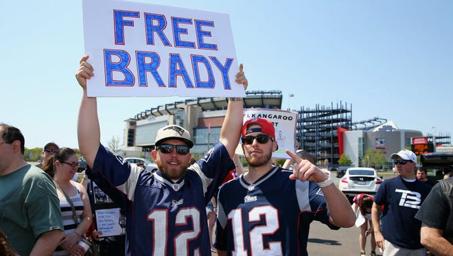 Supporters of Tom Brady rally on May 24, 2015, in Foxboro, Mass.