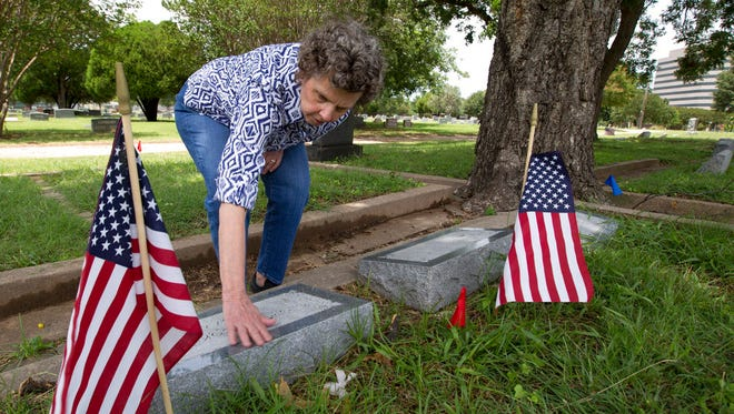 Sherry Coke Dorn, of Arlington, Texas, the second cousin of George Anderson Coke Jr., visits Parkdale Cemetery on Monday, June 19, 2017.  The remains of George Anderson Coke Jr., an Arlington High School graduate who died in the attack on Pearl Harbor, have finally been identified, and are being returned home for a memorial service and burial next to his father and mother at Parkdale Cemetery.  (Joyce Marshall/Star-Telegram via AP)