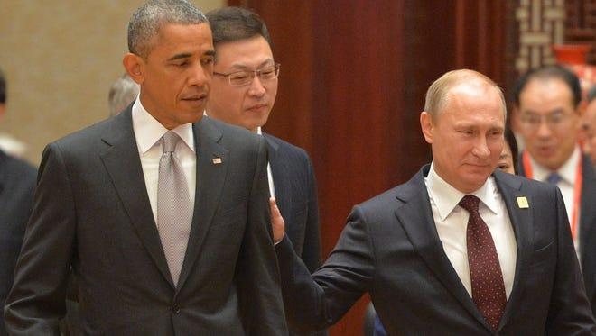 Vladimir Putin (right) touches Barack Obama.