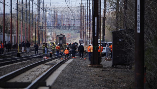 An Amtrak train slammed into a backhoe south of Philadelphia on Sunday morning, injuring passengers and halting service along much of the Northeast corridor, the rail service said.