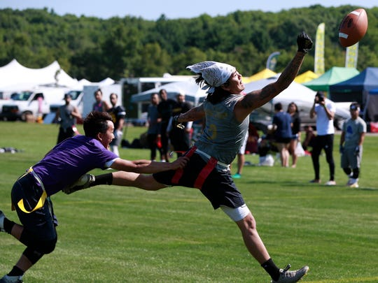 Flag football players compete at the 2018 Hmong Wausau Festival.