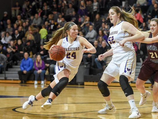 Waukee's Jori Nieman (24) brings the ball down court during a basketball game between the Waukee Warriors and the Dowling Maroons on Tuesday, Jan. 30, 2018, at Waukee High School.