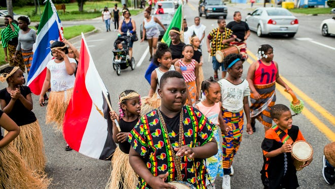 FILE - In this June 19, 2018, file photo, Zebiyan Fields, 11, at center, drums alongside more than 20 kids at the front of the Juneteenth parade in Flint, Mich. Juneteenth celebration started with the freed slaves of Galveston, Texas. Although the Emancipation Proclamation freed the slaves in the South in 1863, it could not be enforced in many places until after the end of the Civil War in 1865.