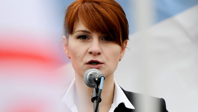 In this photo taken on Sunday, April 21, 2013, Maria Butina, leader of a pro-gun organization in Russia, speaks to a crowd during a rally in support of legalizing the possession of handguns in Moscow, Russia. Butina, a 29-year-old gun-rights activist, served as a covert Russian agent while living in Washington, gathering intelligence on American officials and political organizations and working to establish back-channel lines of communications for the Kremlin, federal prosecutors charged Monday, July 16, 2018. (AP Photo) ORG XMIT: XAZ125