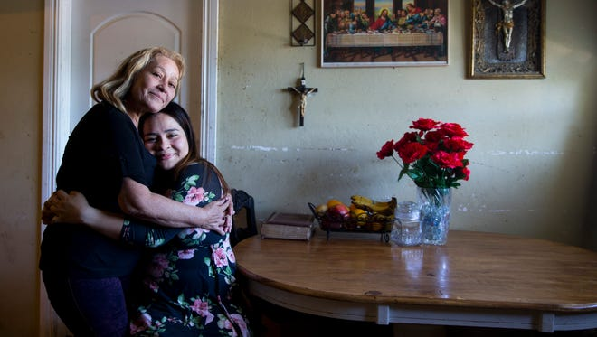 "Jennyfer Gerrero Torres hugs her mother, Maria Torres, at their home in Immokalee, Florida, on Monday, May 8, 2017. Torres is the first student from Immokalee High School to gain acceptance to Harvard University as an undergrad. ""She was really happy and she thanked God. She had been praying that I would get in,"" says Jennifer about her mother's reaction to her acceptance letter."