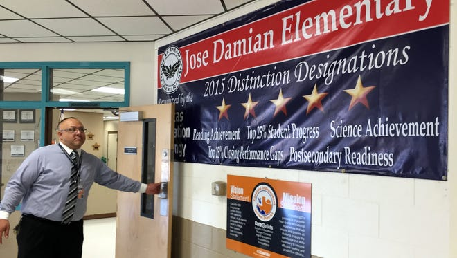 Principal Jesus Barba opens the door to the front office at Jose H. Damian Elementary School, the lone Canutillo Independent School District campus to receive all possible state distinctions last year.