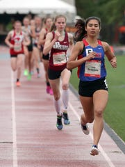 Jade Sessions of Carmel competes in the Loucks Mile