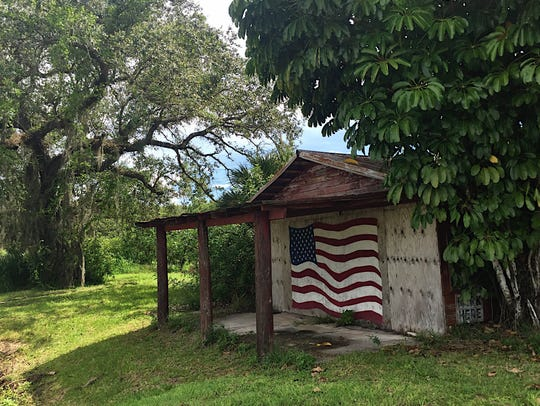A hand-painted flag decorates the front of this barn