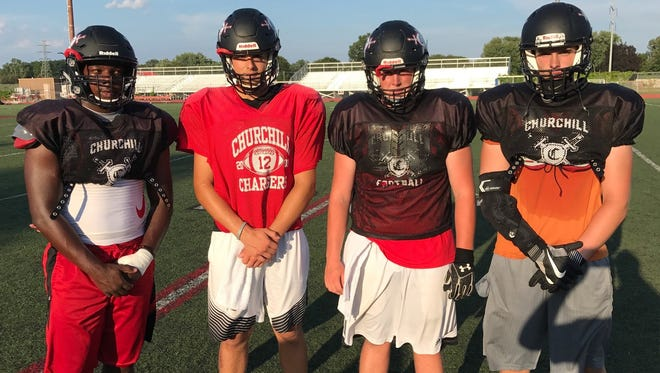 Livonia Churchill captains (from left) Mike Parrish, Drew Alsobrooks, Colin McCuster and Steve Darichuk can't wait to open the 2017 high school football season.