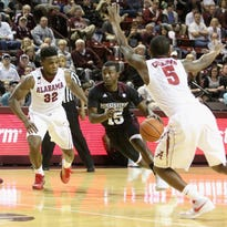 Mississippi State guard I.J. Ready (15) drives to the basket between Alabama defenders Retin Obasohan (32) and Justin Coleman (5) recently in Starkville, Miss.