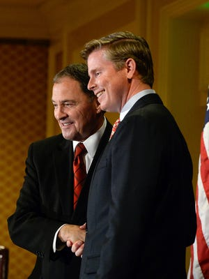 Republican candidates for Utah governor, incumbent Gary Herbert, left, and Jonathan Johnson, pose for photographs following the first fledged debate at the Little America Hotel in Salt Lake City on Monday, April 11, 2016.