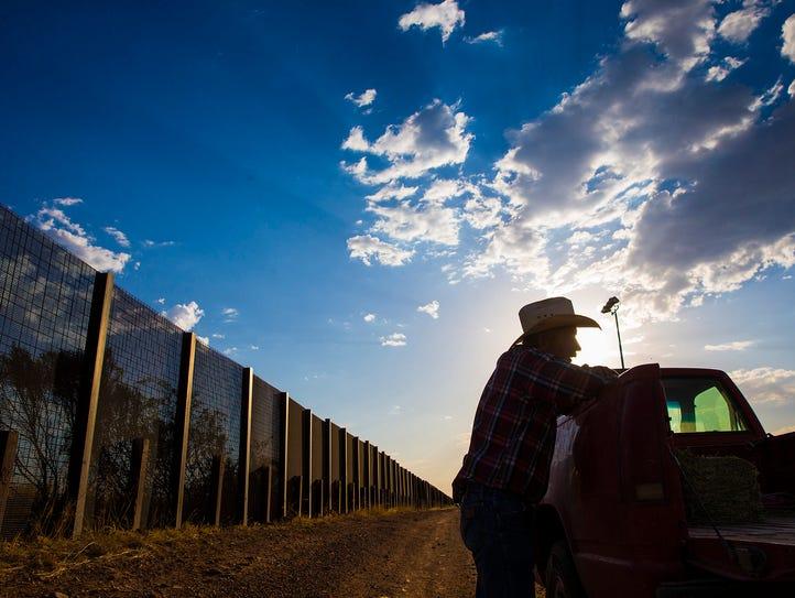 May 5, 2017; Naco, Ariz, USA; Rancher John Ladd leans
