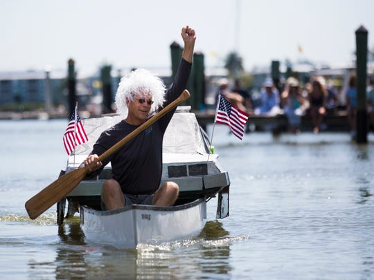 Edward Teed with Edgewater Pools and Spas throws his fist in the air during the Theme Canoe Parade during the 41st annual Great Dock Canoe Race at the Naples City Dock at Crayton Cove on Saturday, May 6, 2017. This years races featured a ÒBack to the FutureÓ theme.