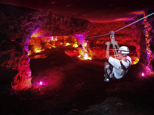 """Corey Malone heads down the """"Zipline to Hell"""" zip line course at the Louisville Mega Cavern."""