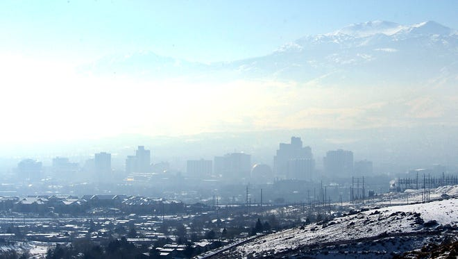 A haze. caused by an inversion, sits over Reno Friday Jan. 4, 2013. Local forecasters say muddy air could get trapped from an inversion over Reno.