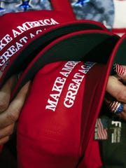 """President Donald Trump's 2016 campaign popularized """"Make America Great Again"""" hats with supporters."""