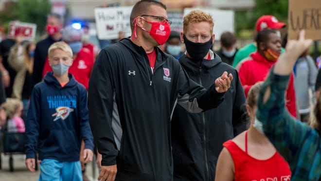 Bradley men's basketball head coach Brian Wardle, in red Bradley mask, chats while marching with athletes and athletic department staffers during a peaceful protest Tuesday, June 9, 2020 down Main Street in Peoria.