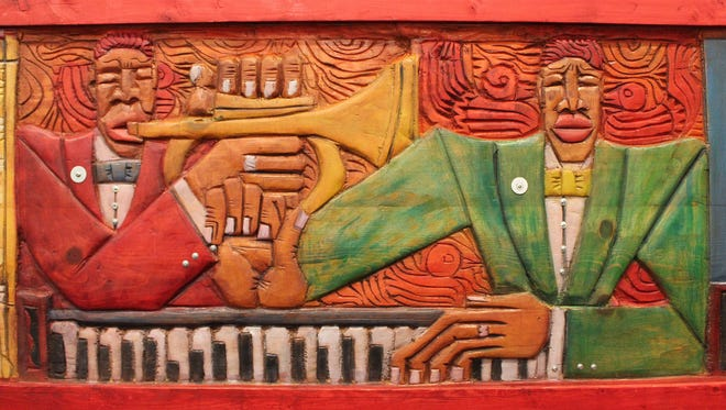 """LaVon Williams, """"Bird Came Late,"""" painted, carved wood, 25.75 x 52 in."""