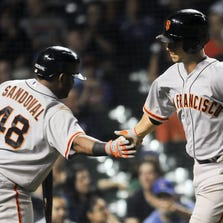 Aug 19, 2014; Chicago, IL,  San Francisco Giants third baseman Pablo Sandoval (48) congratulates catcher Buster Posey (28) after he hits a home run in the fifth inning of the game against the Chicago Cubs at Wrigley Field.
