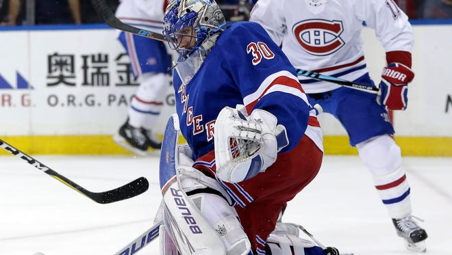 New York Rangers goalie Henrik Lundqvist makes a save during the first period in Game 3 of an NHL hockey first-round playoff series against the Montreal Canadiens, Sunday, April 16, 2017, in New York. (AP Photo/Seth Wenig)