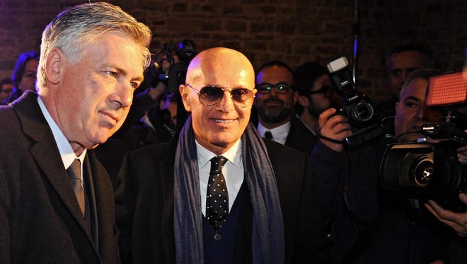 Real Madrid's head coach Carlo Ancelotti (L) arrives with Arrigo Sacchi (R) to the Italian Football Hall of Fame at Palazzo Vecchio in Florence, Italy on Jan. 19, 2015.