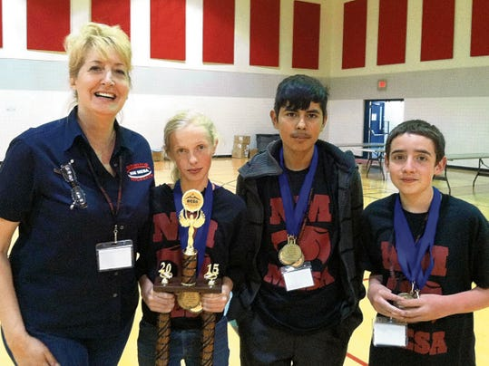 Courtesy Photo   Monika Velez, Red Mountain Middle School MESA sponsor, poses with MESA national qualifiers Adriana Darrow, Javier Rodriguez and Freddie Sanchez.